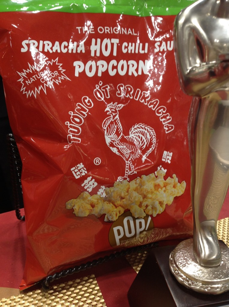 "Google ""sriracha popcorn"" and a bunch of companies come up. But Pop! Gourmet Popcorn cleverly turned their package into a Sriracha-lover's magnet — red hot. Check out their shirts. Their use of the Sriracha brand is a winner for Sriracha appeal."